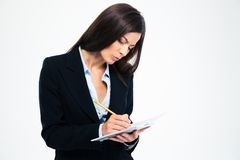 Businesswoman writing notes in notebook Royalty Free Stock Photography