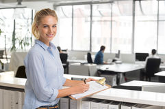 Businesswoman writing notes Royalty Free Stock Image