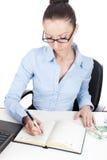 Businesswoman writing in organizer Royalty Free Stock Photos