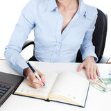 Businesswoman writing in organizer Royalty Free Stock Photography