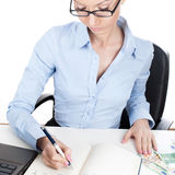Businesswoman writing in organizer Stock Images