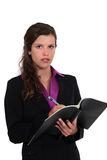 Businesswoman writing in a pad Stock Photo