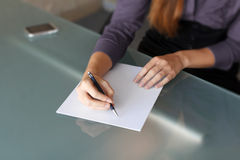 Businesswoman writing with pen 2 Stock Image