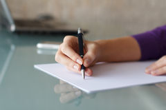 Businesswoman writing with pen Royalty Free Stock Photos