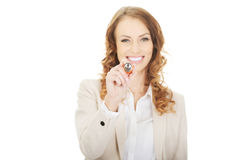 Businesswoman writing with pen. Stock Photo