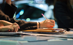 Businesswoman writing with pen Royalty Free Stock Images