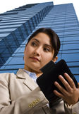 A Businesswoman Writing in a Personal Organizer Stock Photography