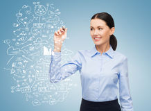 Businesswoman writing plan in the air Stock Image