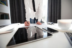 Businesswoman writing in planner Stock Photos