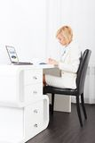 Businesswoman writing, signing up paper document Royalty Free Stock Images