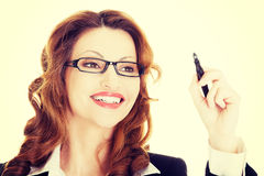 Businesswoman writing something on abstract screen Royalty Free Stock Images