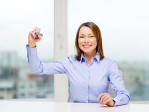 Businesswoman writing something in the air Royalty Free Stock Photography