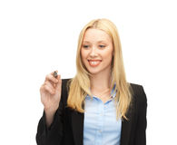 Businesswoman writing something in the air. With marker stock photo