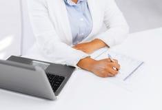 Businesswoman writing something Royalty Free Stock Photos