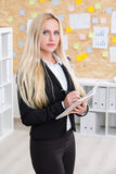 Businesswoman writing something down Royalty Free Stock Photography