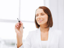 Free Businesswoman Writing Something In The Air Royalty Free Stock Photography - 34951487