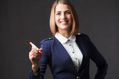 Businesswoman writing something with a red marker. Royalty Free Stock Photos