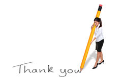 Businesswoman writing Thank you with giant pencil. Businesswoman writing the words Thank you with a giant pencil, isolated on a white background stock photos