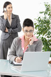 Businesswoman writing to organizer Royalty Free Stock Photography