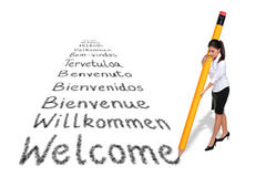 Businesswoman writing Welcome in various languages