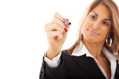 Businesswoman writing at the whiteboard Royalty Free Stock Images