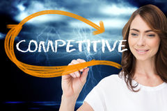 Businesswoman writing the word competitive Royalty Free Stock Photos