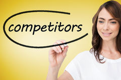 Businesswoman writing the word competitors Stock Images