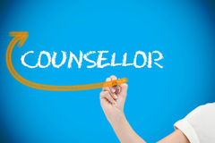 Businesswoman writing the word counsellor Stock Photos