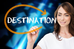 Businesswoman writing the word destination Stock Images