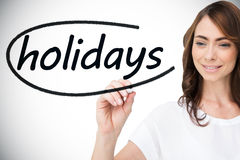 Businesswoman writing the word holidays Royalty Free Stock Images