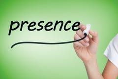 Businesswoman writing the word presence Stock Photo