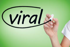 Businesswoman writing the word viral Stock Photography