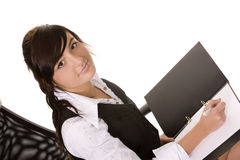 Businesswoman writting Stock Images