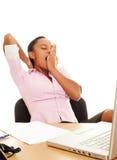 Businesswoman yawning Stock Photo