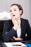 Businesswoman yawning in an office Royalty Free Stock Photos