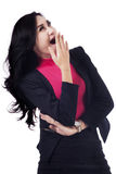 Businesswoman is yawning in studio Royalty Free Stock Photo