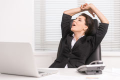 Businesswoman yawning. Royalty Free Stock Photos