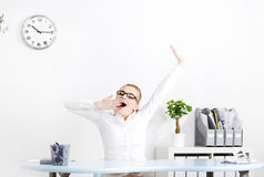 Businesswoman yawninig in the office. Royalty Free Stock Photo