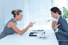 Businesswoman yelling at colleague Royalty Free Stock Image