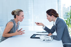 Businesswoman yelling at colleague Royalty Free Stock Photography