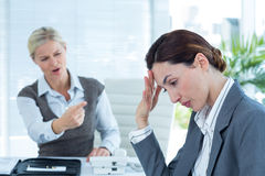 Businesswoman yelling at colleague Stock Photo