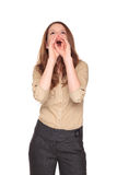 Businesswoman - yelling hand megaphone. Isolated studio shot of the front view of a Caucasian businesswoman yelling while using her hands as a megaphone Royalty Free Stock Image