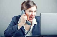 Businesswoman Yelling Into The Phone Royalty Free Stock Image