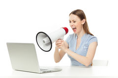 Businesswoman yelling at laptop Royalty Free Stock Image
