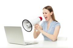 Businesswoman yelling at laptop Royalty Free Stock Image
