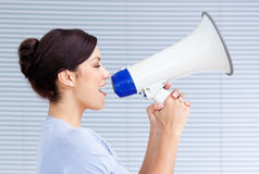 Businesswoman yelling through a megaphone Stock Photography
