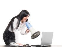 A businesswoman yelling with a megaphone Royalty Free Stock Image