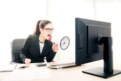 Businesswoman yelling through a megaphone Royalty Free Stock Images