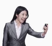 Businesswoman yelling at mobile phone Stock Photography