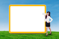 Businesswoman yelling next to copyspace outdoors Royalty Free Stock Images